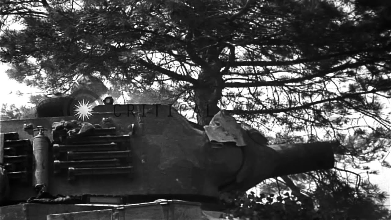 Download United States M4 medium tank and M8 HMC are fired by US Troops in France. HD Stock Footage