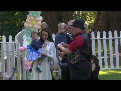 Princess Charlotte chases bubbles and Prince George plays with balloons