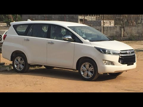 Toyota Innova crysta white, garnet red and bronze co