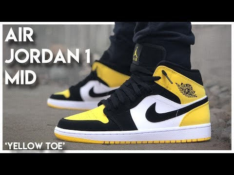 black and yellow jordans