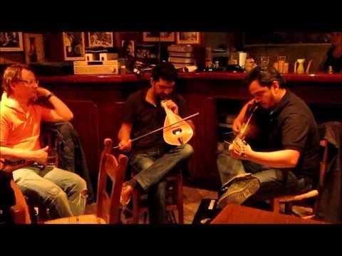 VRANAS AND MARAGOUDAKIS ARE PERFORMING VERY WELL CRETAN MUSIC