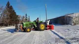 5020 pushing snow with the hyd angle blade!