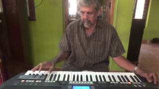 ponnambal puzhayirambil-harikrishnans on keyboard with karaoke