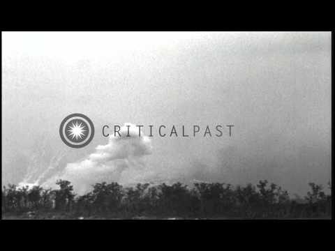 Marines aboard USS Honolulu fire at Peleliu Island, Palau. HD Stock Footage