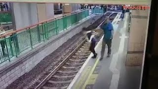 Man pushes woman onto Hong Kong rail tracks, casually walks away