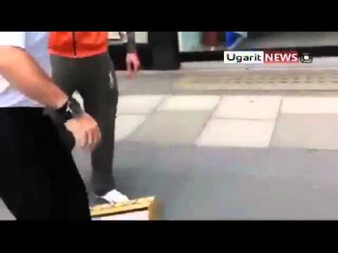 London   Syria Dictator's Picture Smashed at Syria Airlines Office  8 11 11