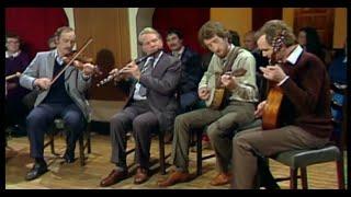Conor Tully (fiddle) Paddy Carty (flute) Pádraig MacDonncha (banjo) Frank Hogan (mandola)