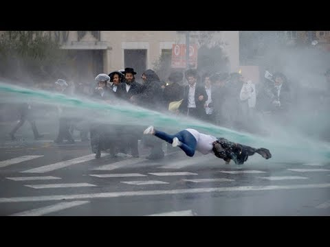 RAW: Innocent woman knocked down by Israeli 'skunk cannon'