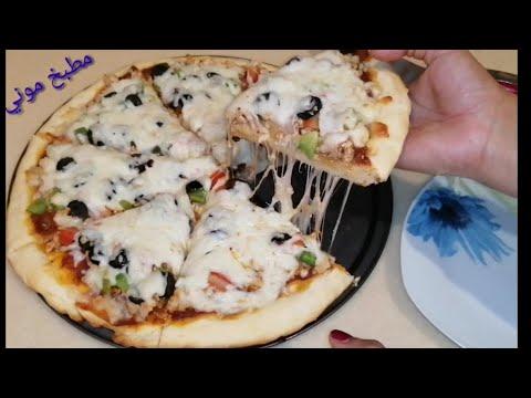 صورة  طريقة عمل البيتزا طريقة عمل بيتزا بالفراخ بكل سهولة زي بيتزا المحلات بعجينة هشة وطرية طريقة عمل البيتزا بالفراخ من يوتيوب