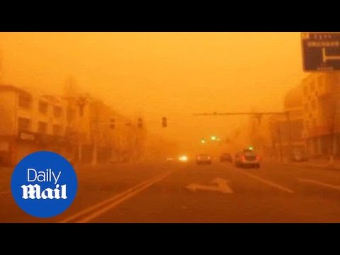 Sandstorm turns sky orange in Inner Mongolia - Daily Mail