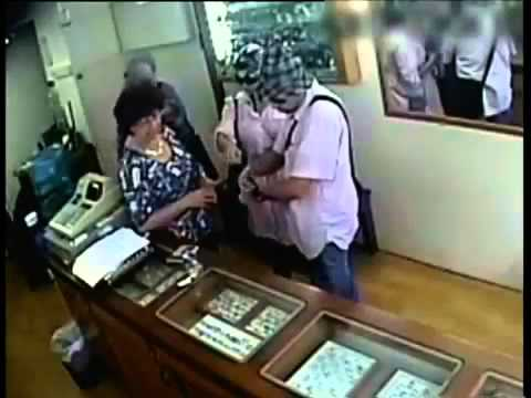Professional disguise thieves group  in action   stealing from jewelry shop, CCTV footage