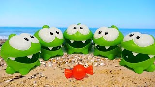 Om Nom & toy cars on the beach. Toy videos.