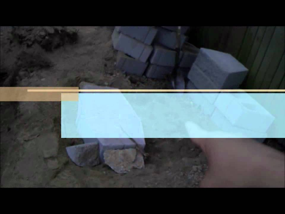 How To Install A Retaining Wall And A Cedar Fence Youtube