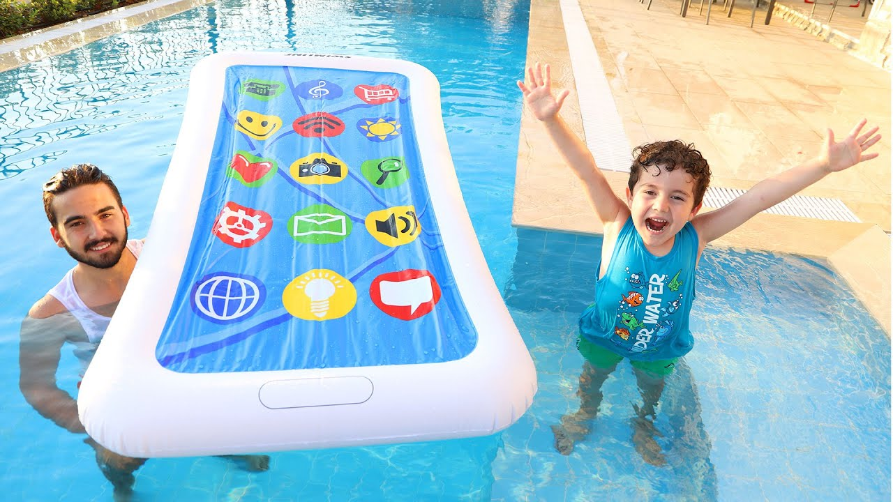 Yusuf plays on the phone at the pool