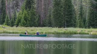 Young couple in love canoe high mountain lake Scenic high mountain lake used for recreation can