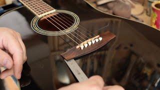 Repairing A Lifting Acoustic Guitar Bridge