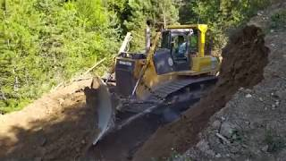 Cutting Slope with a Dozer - Open forest road - Construction Road Komatsu D 85 EX Dozer