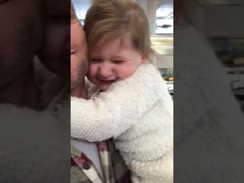 Little girl is happy to see her dad