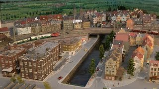 Model Railroad Display with Miniature Cars and Bumper Cars and 100 Trains in HO Scale
