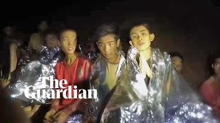 Boys trapped in Thailand comforted by rescuers