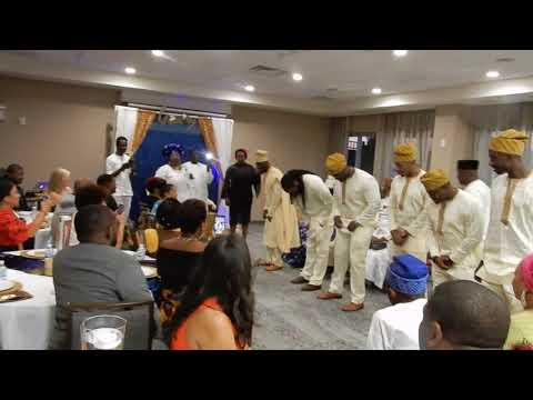DSCN0846 Nigerian engagement ceremony / groom and groomsmen lay prostrate according to culture