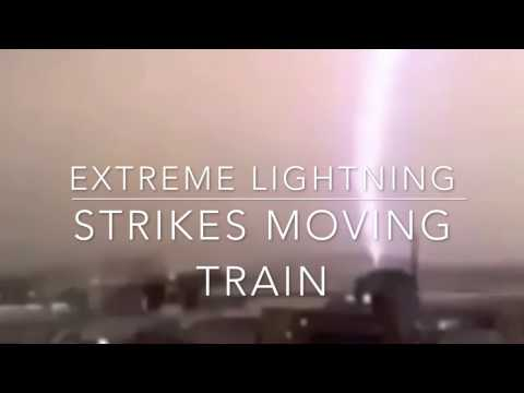 *Extreme Lightning Bolt* strikes moving passenger train! Glowing energy exits front car of train!