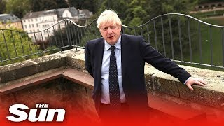 PM Boris Johnson gives an interview after skipping Luxembourg news conference