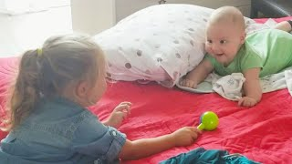 Cute Baby And His Daughter Playing And Laughing