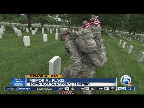 American flags placed on graves at the South Florida National Cemetery for Memorial Day weekend