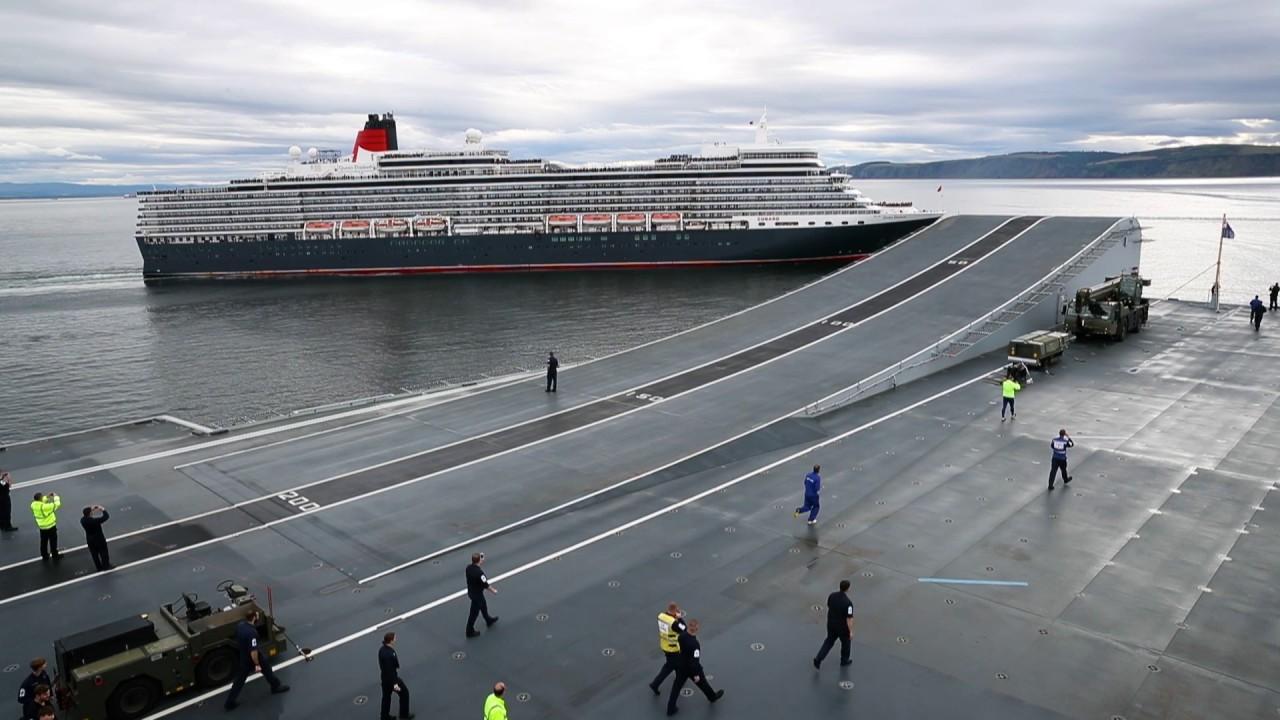 HMS Queen Elizabeth meets cruise liner MS