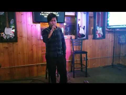 It's Elvis Presley but an Asian guy sings it at a karaoke bar