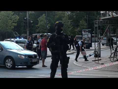 Man shot by police in central Copenhagen - news report from scene