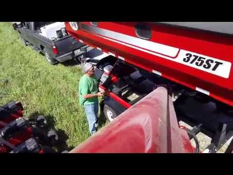 J&M Speed Tender 375 loading soybeans in a 1250 Case IH
