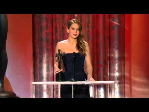 Jennifer Lawrence rips dress on way up to collect SAG Award