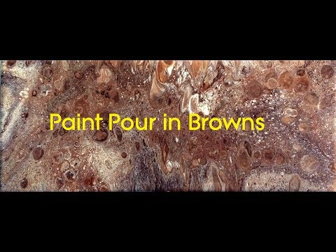 Acrylic paint pour using blues and browns with floetrol and silicone