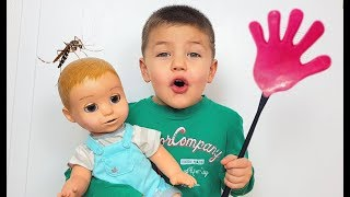 Richard protects baby doll from mosquitoes