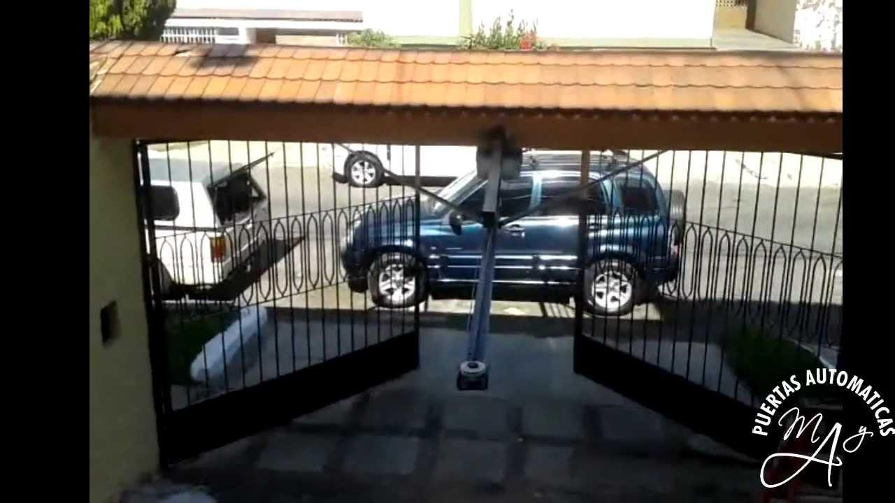 Port n abatible hacia afuera puertas autom ticas may for Puertas que abren hacia afuera