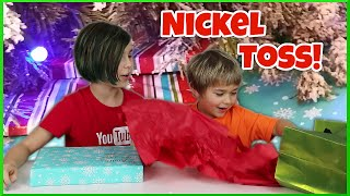 christmas nickel toss challenge early surprise present opening game family fun