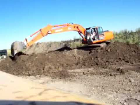 Digger Moving Dirt Piles Excavation Station
