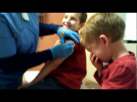 3 year old cries before his flu shot