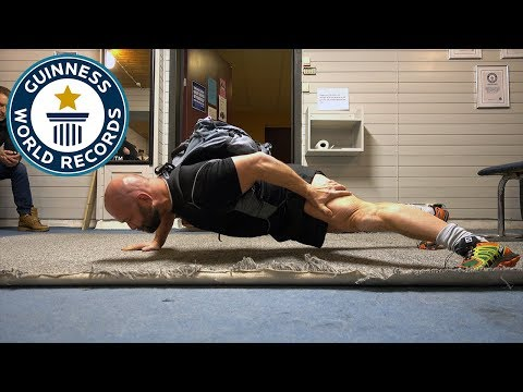One arm push ups with a 100 lb pack – Guinness World Records