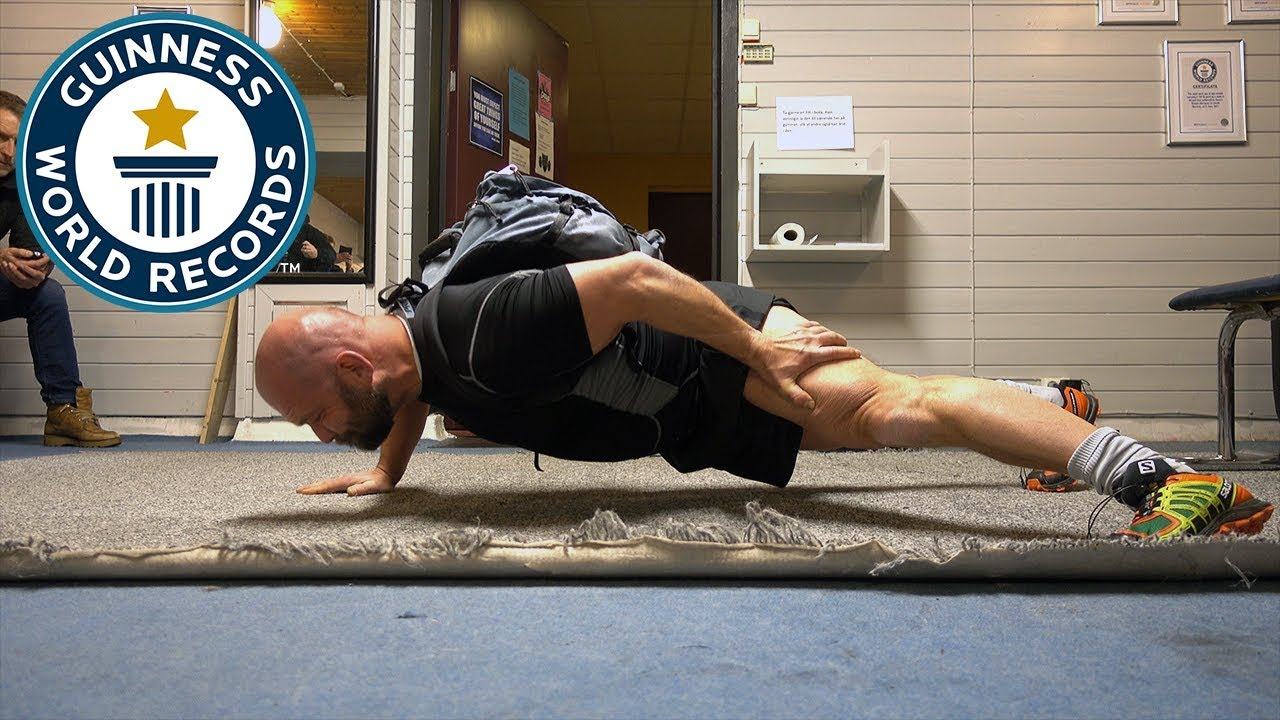 One arm push ups with a 100 lb pack - Guinness World Records