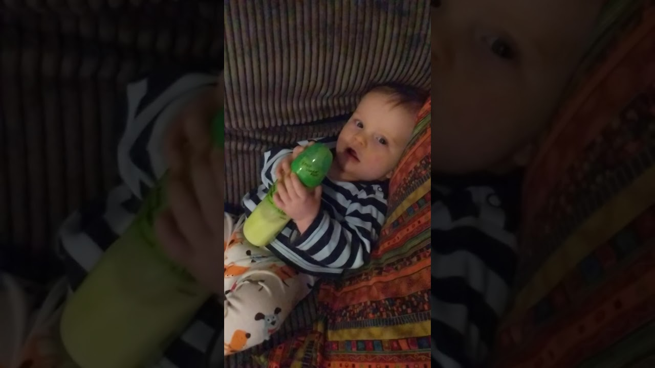 Baby can hold his own bottle - YouTube