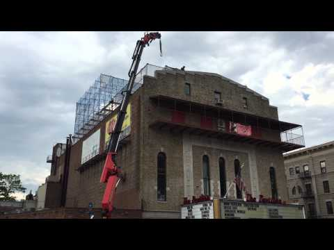 Crane lifts to penthouse