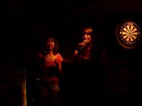 Constanza and Patricia singing Karaoke
