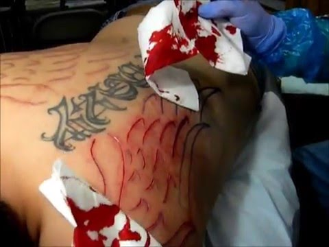 Scarification / Cutting / Branding / Giving Angel His Wings / Scar Tattoo