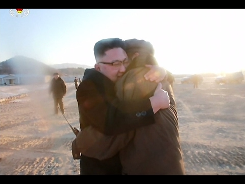 North Korea's TV report praises missile test, shows happy Kim hugging a man