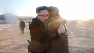 North Korea's TV report praises missile test, shows happy Kim hugging a man
