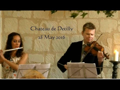 Flute and violin play Pachelbel's Canon for bride's entry.