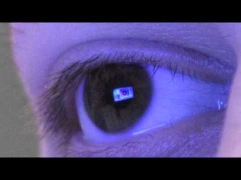 Laptop screen reflected in eye